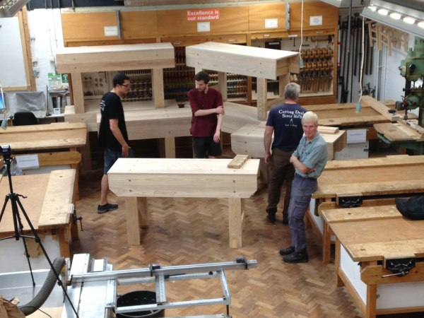 A stack of a few benches. Note that the legs are still over-long. Many of the students wanted high workbenches. Who am I to argue.
