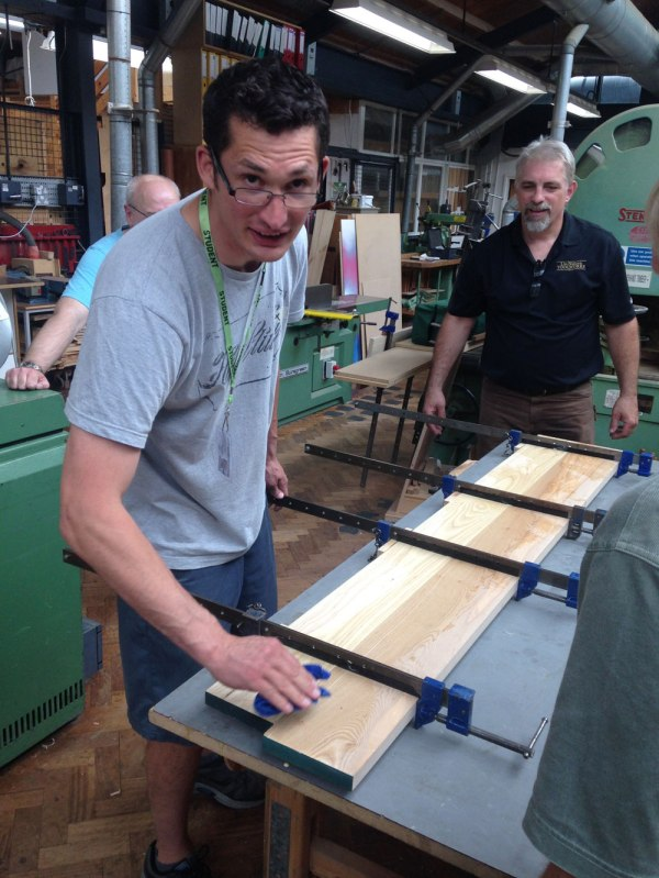 Alex Primmer and Deneb Puchalski during one of the many panel glue-ups last week.