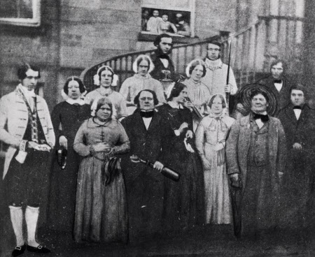 Erddig servants on the front steps. Thomas Rodgers is front row, second from right; his son James is next to him.