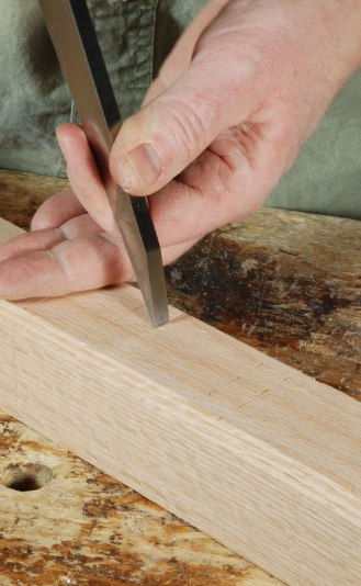 Fig. 4.5. Now move the chisel over one chisel-width. And lean on it. Now your setting is marked on the timber, and you just need to set the mortise gauge according to the chisel marks.