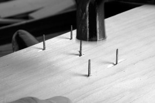 I have a steel plate behind the head of this nail as I clinch it. Here is the nail tip right before the first strike.