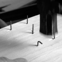 After two strikes the nail's tip is at a 90° angle to where it was originally.