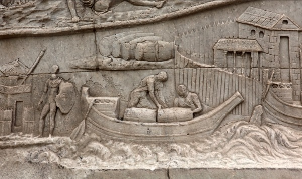 Loading barrels on a boat in the Danube, Trajan's Column in Rome, completed 113 AD.