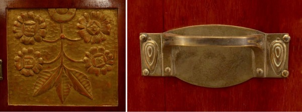 Carved sunflower panel and brass drawer pulls.