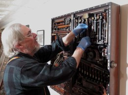 Don studying the tool cabinet of Henry O. Studley.