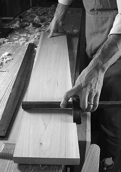 Gauge your width. A panel gauge marks the board's finished width. Make this mark on both faces.